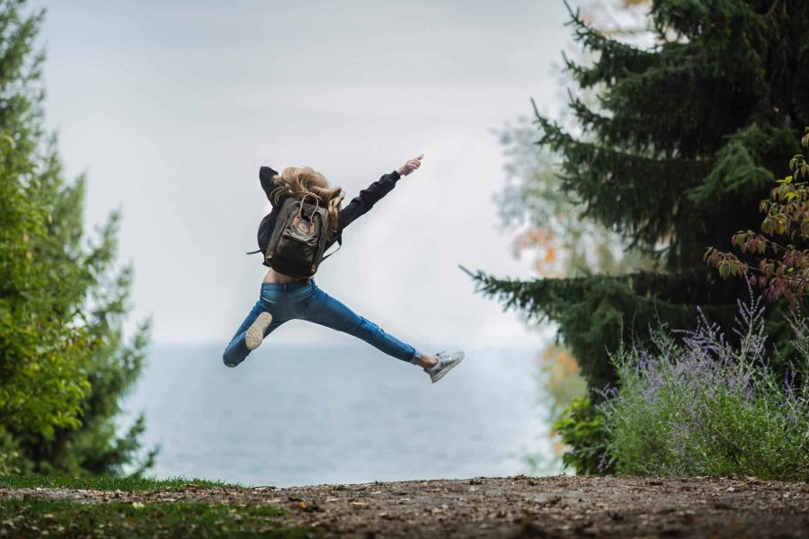 A girl jumping for joy after successful individual counseling in Parker
